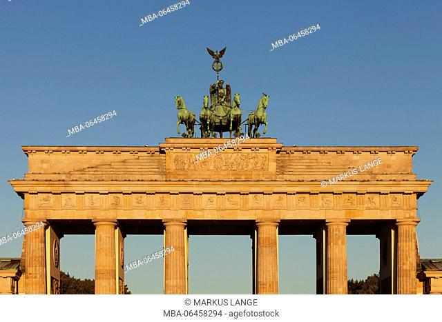 The Brandenburg Gate with quadriga at sunrise, the Mitte district of Berlin, Berlin, Germany