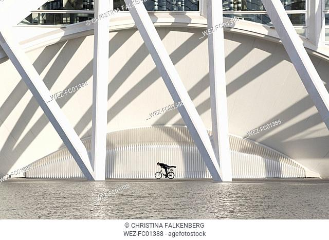 Spain, Valencia, City of Arts and Sciences, man on bicycle