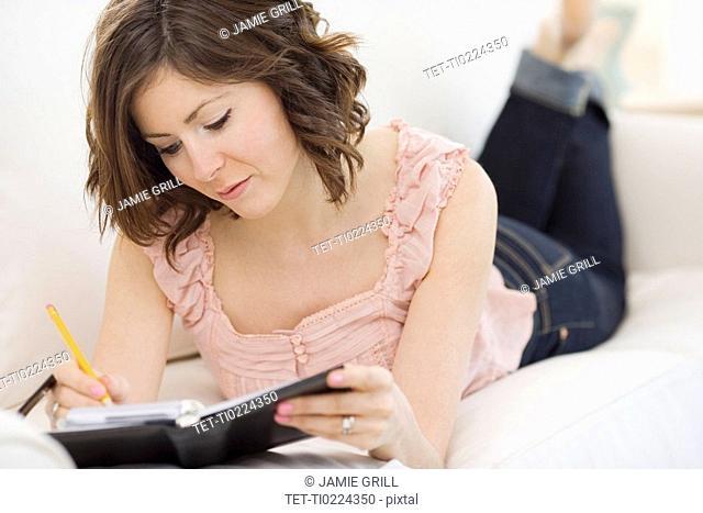 Woman writing in date book