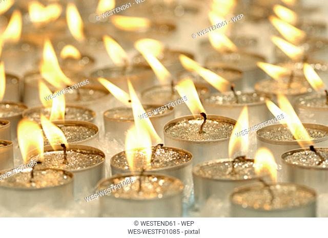 Burning tea lights, Christmas decoration