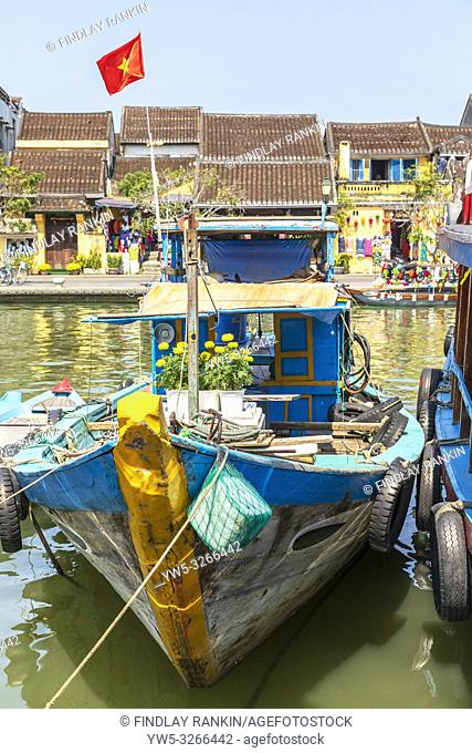 Tradaitional Vietnamese fishing boat at Hoi An harbour, on Son Thu Bon River, Quang Nam Provence, Vietnam, Asia