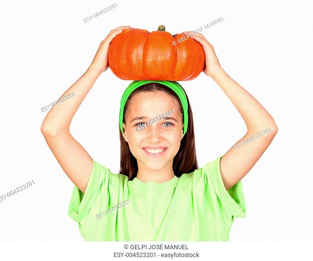 Happy girl in Halloween with a big pumpkin