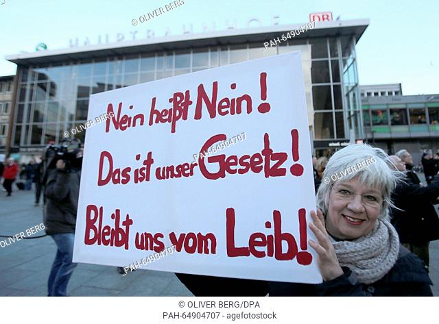 """A demonstrator holds a sign that reads """"""""Nein heißt Nein! Das ist unser Gesetz! Bleibt uns vom Leib!"""""""" (lit. No means no! That is our law! Keep your hands off..."""