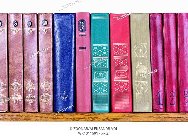 Old Books with color covers on a shelf