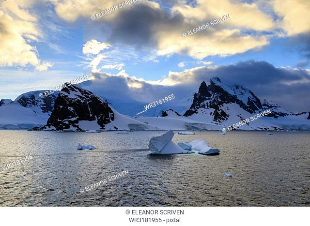 Sunrise, atmospheric clouds, mountains, glaciers and icebergs, Danco Coast, Gerlache Strait, Antarctic Peninsula, Antarctica, Polar Regions