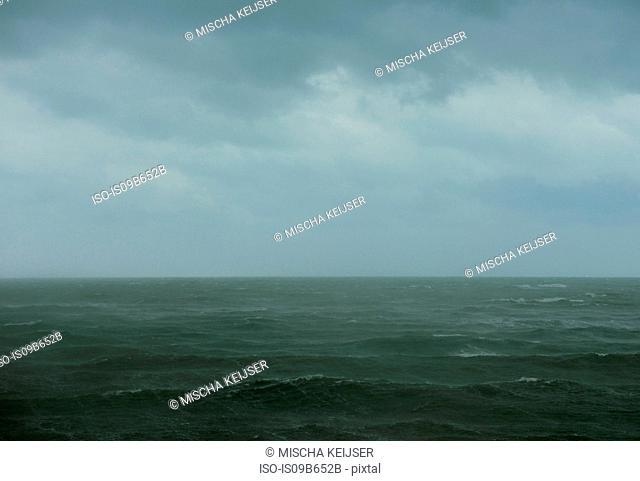 Scenic view of rain over sea, Scheveningen, South Holland, Netherlands, Europe