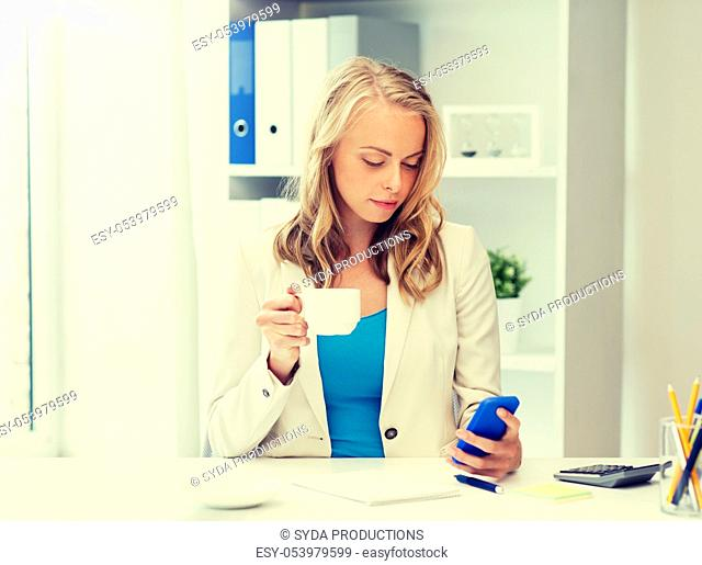 businesswoman texting on smartphone at office