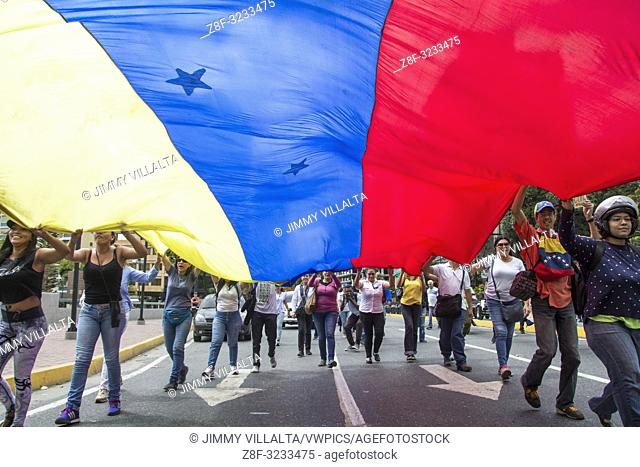 Young people display a seven (7) star Venezuelan flag. New protests were held in Venezuela, to demand the exit of the ruling Nicolás Maduro and to back the...