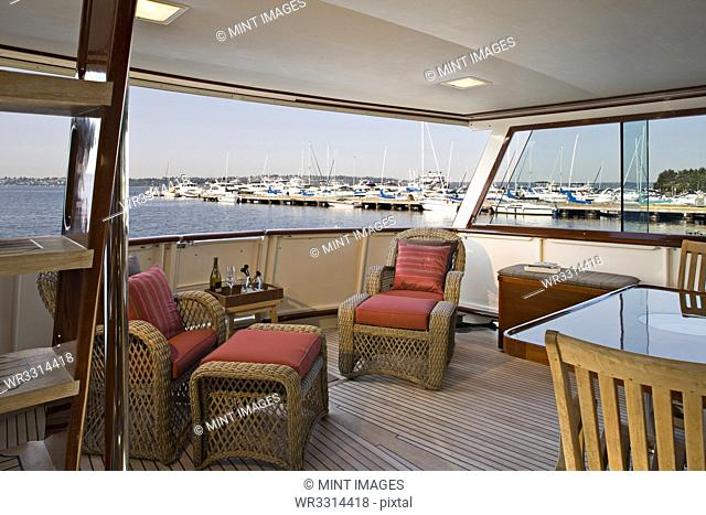 Armchairs in lounge area of yacht