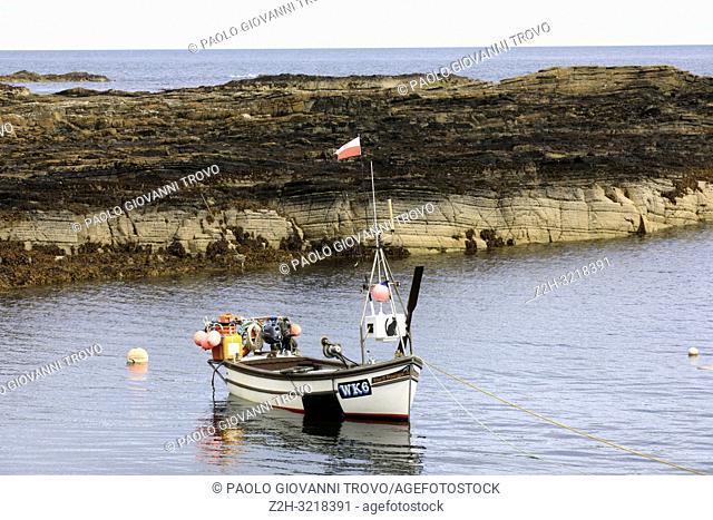 A fishing boat at Dornoch Beach, Dornoch, Scotland, Highlands, United Kingdom