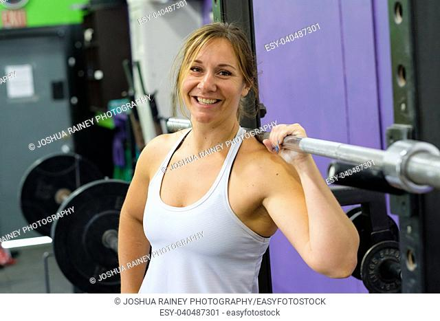 Portrait of a fit young woman at a crossfit gym for female athletes