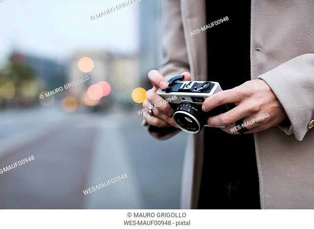 Close-up of man outdoors holding camera