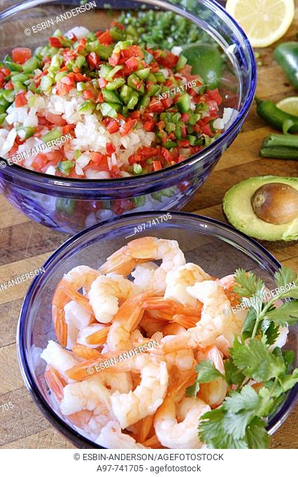 Bowl of shrimp, another of diced peppers, onions, & tomatoes. Ingredients for Ceviche