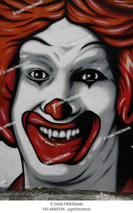 Graffiti art mural depicting Ronald McDonald as a vampire in Ontario, Canada. Ronald McDonald is a clown character and is the mascot of the McDonald's fast-food...