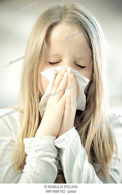 Sick girl blowing her nose, Osijek, Croatia