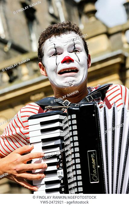 Freddy Crossley playing an accordion and advertising a show at Edinburgh Fringe festival, High Street, Royal Mile, Edinburgh, Scotland