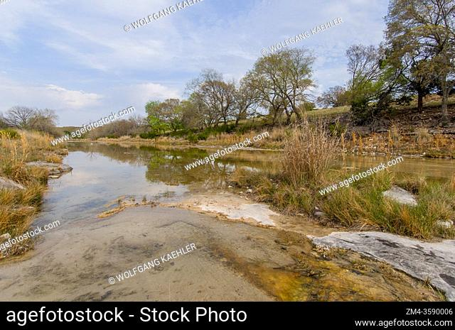 A small river flows through Stowers Ranch in the Hill Country of Texas near Hunt, USA