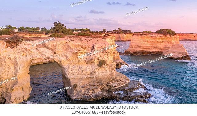 Meledugno town in Italy, Puglia Region. Spectacular view at sunrise on Santo Andrea cliffs