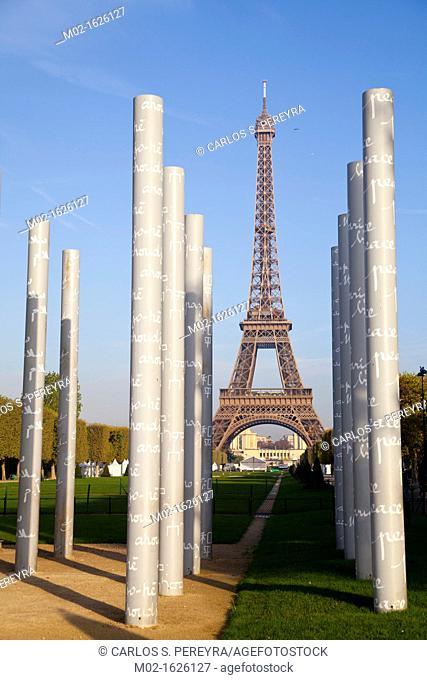 View of the Eiffel Tower, Tour Eiffel, Champ de Mars, 'Les murs de la paix' artwork on Place Joffre, Paris, Ile de France, France, Europe