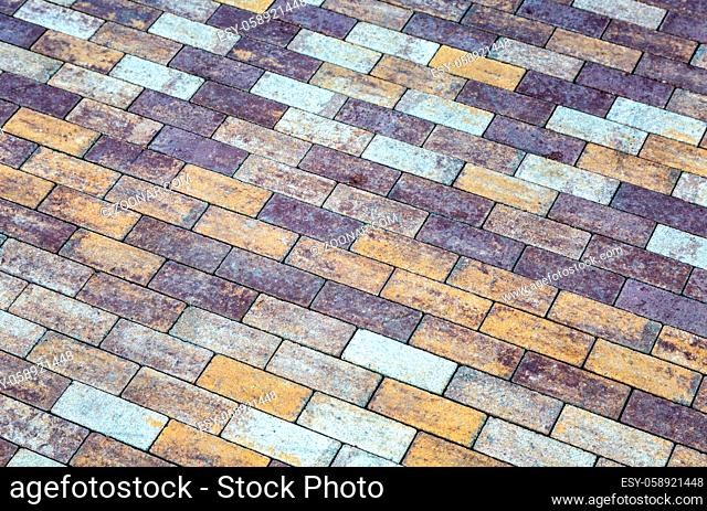 Grey paving stones as background texture close up