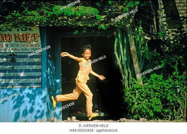 Vietnam Mekong Delta little girl waving friendly from dike