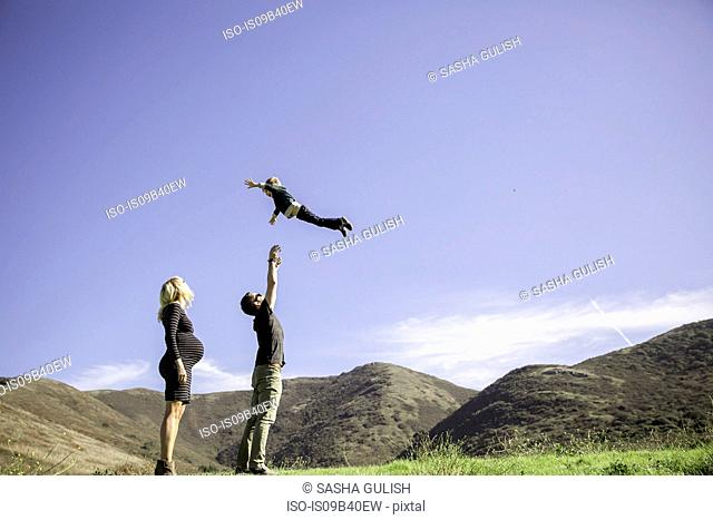 Parents and boy enjoying day outdoors
