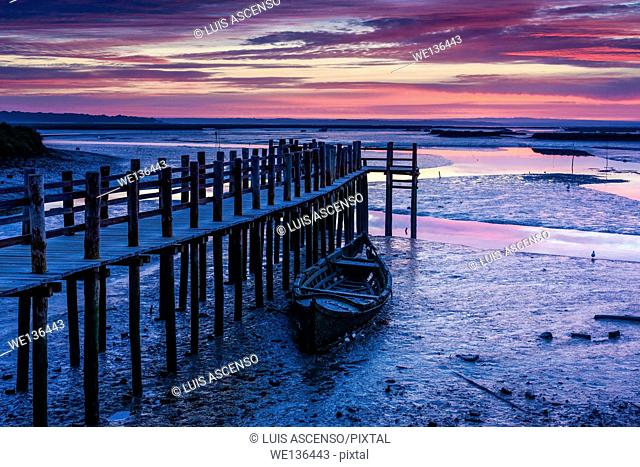Mourisca sunrise, Sado river, Mourisca tidal mill, Portugal, Setúbal, pier stilts in wood, low tidal