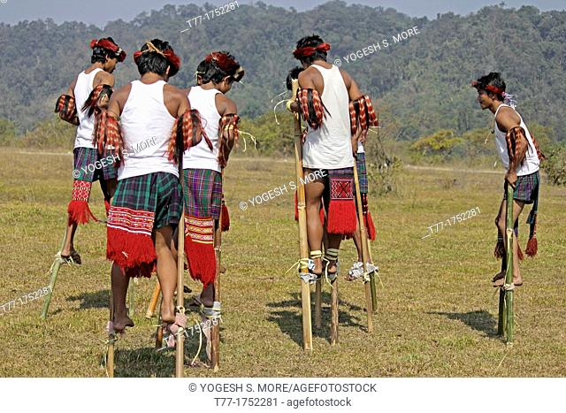 Nocte warrior tribes, playing bamboo stilts game at Namdapha Eco Cultural Festival, Miao, Arunachal Pradesh, India