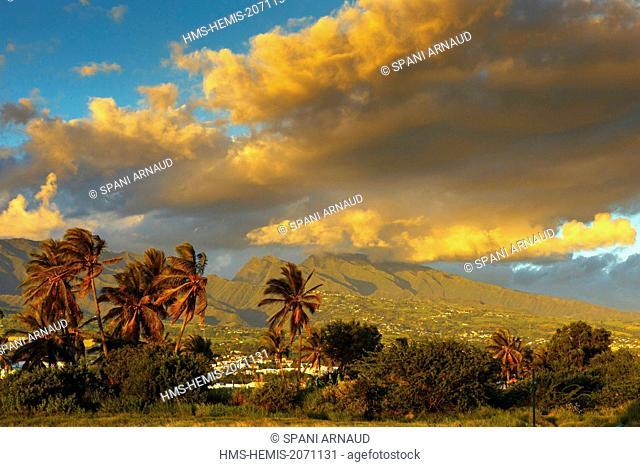 France, Reunion Island, Saint Louis, natural tropical mountain landscape at sunset under a cloudy sky