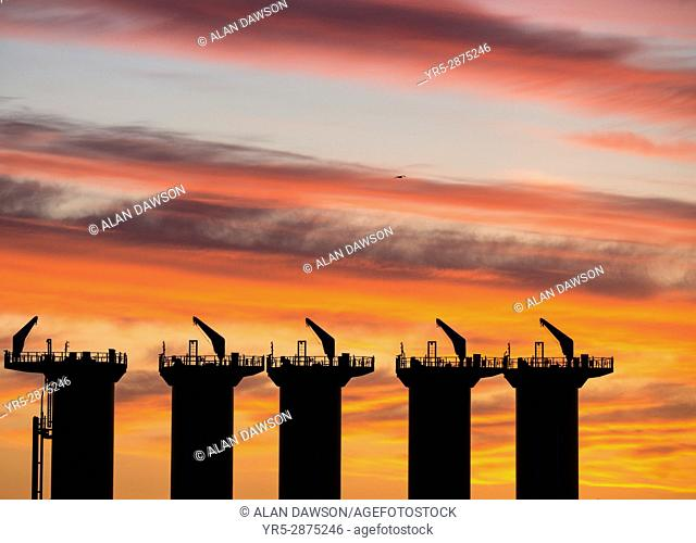 Wind turbine factory at sunrise. Offshore Structure Britain, a company manufacturing wind turbines at Haverton Hill near Middlesbrough and Billingham on the...