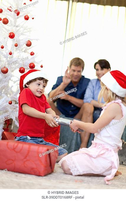 Children opening Christmas cracker