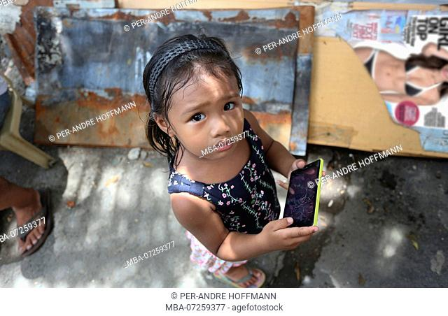 Girl with smartphone in Manila, Metro Manila, Luzon Island, Philippines