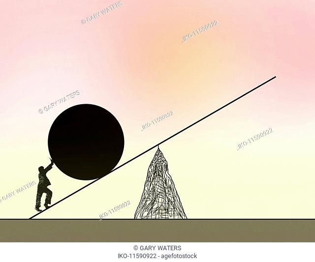 Businessman pushing large ball up seesaw