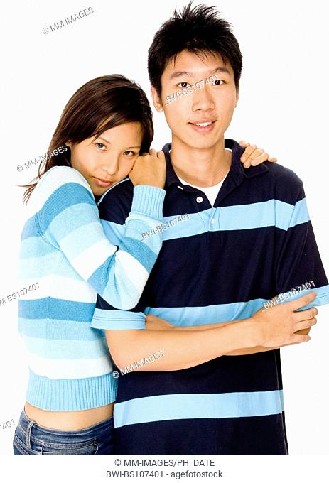 A loving young Asian couple