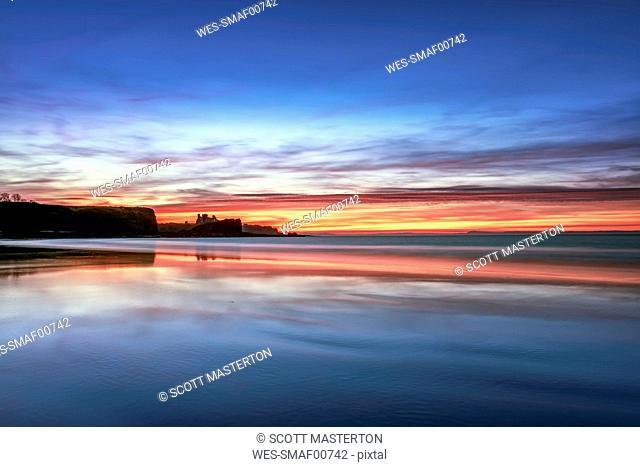 UK, Scotland, East Lothian, Tantallon Castle at sunset from Seacliff beach