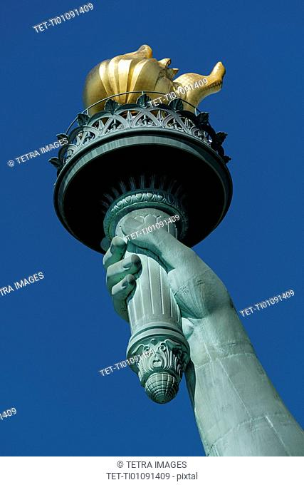 Torch of Statue of Liberty against clear sky