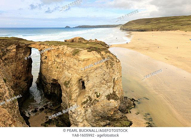 Perranporth, Cornwall, England, UK, Great Britain, Europe  Natural rock arch at Droskyn Point with Perran beach beyond