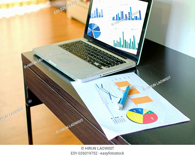 business documents with charts growth, and pen