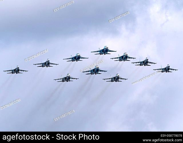 MOSCOW, RUSSIA - MAY 7, 2021: Avia parade in Moscow. su-35 and su-34 and su-30 in the sky on parade of Victory in World War II in Moscow, Russia