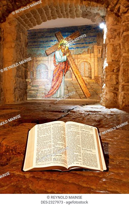 Close-up of Bible and mural with Jesus Christ; Jerusalem, Israel