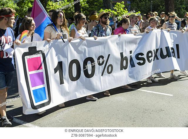 Madrid, Spain, 7 th July 2018. Gay pride parade with participants and a banner in Paseo del Prado, 7 th July 2018, Madrid