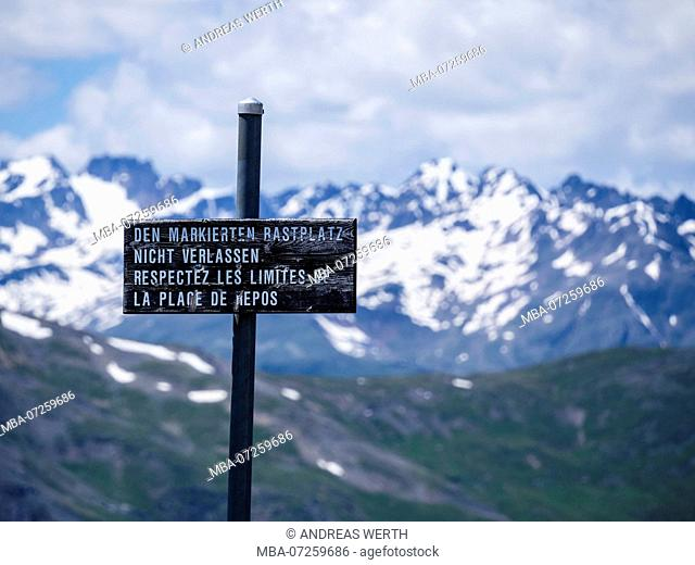 Signpost on top of mountain Munt la Schera, not allowed to leave the path, Swiss National park
