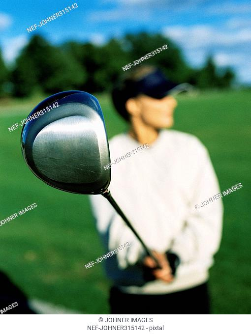 A man using his golf club, close-up, Sweden