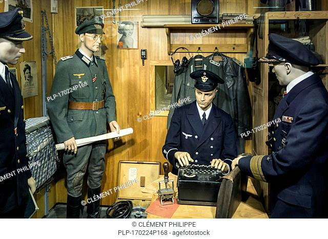 German WWII officer using 3-rotor Wehrmacht Enigma machine at Raversyde Atlantikwall / Atlantic Wall museum at Raversijde, Flanders, Belgium