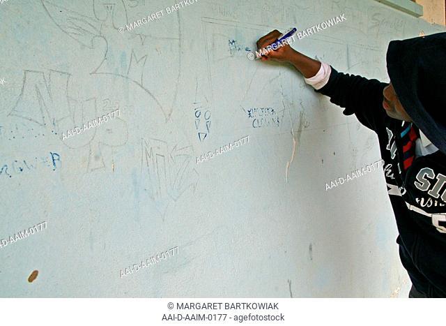 School boy graffiting, St Mark's School, Mbabane, Hhohho, Kingdom of Swaziland