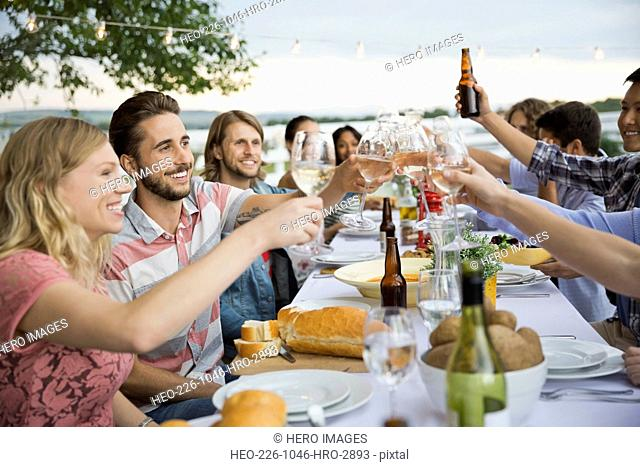 Group of friends toasting at an outdoor dinner party