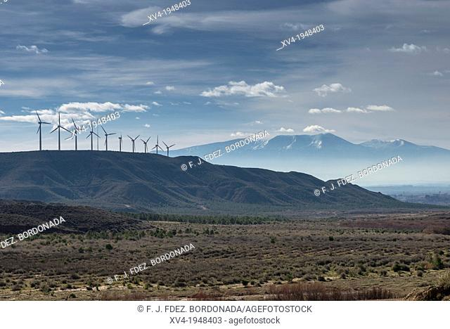 Windmills at Tudela road to Ejea de los Caballeros, with Moncayo Pic background. Navarre, Spain