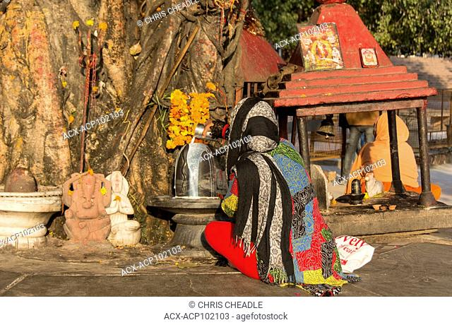 Worshipping Shiva Lingam at Rishikesh, Uttarakhand, India