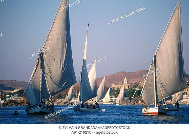 EGYPT.NUBIA.ASWAN.FELUCCAS ON RIVER NILE AT DUSK