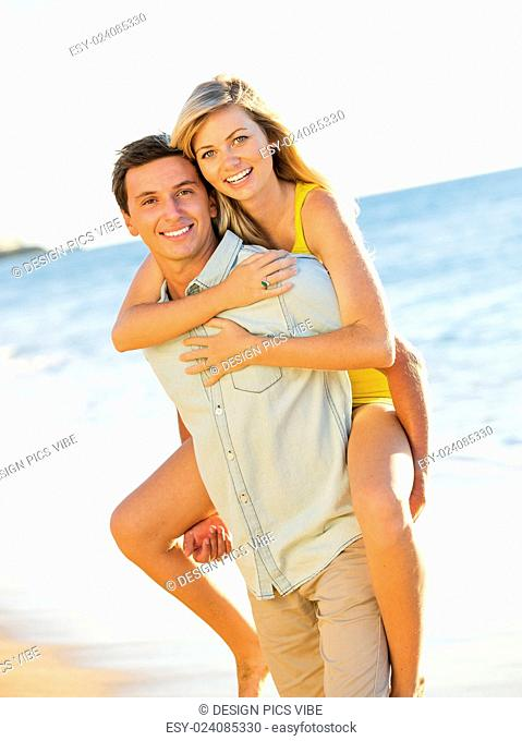 Romantic Couple Enjoying Sunset on Beautiful Tropical Beach
